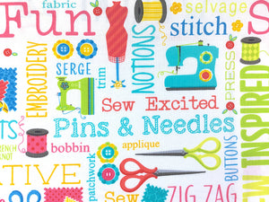 Close up of sewing machines, thread, scissors and sewing sayings.