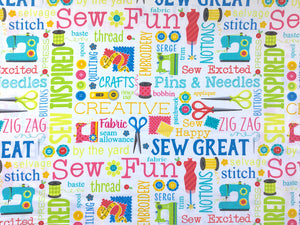 White cotton fabric covered with scissors, sewing machines, rotary cutters, tape measures, thread and sayings such as sew great and pins & needles.