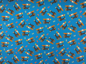 Blue cotton fabric covered with sewing machines.