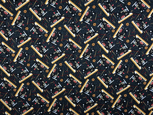 Black cotton fabric covered with sewing machines.