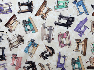 Cream cotton fabric covered with pink, blue, green and black sewing machines.