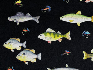 Close up of the various fish and lures on a black background.
