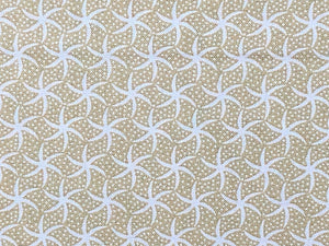 Beige Cotton Fabric covered with rows of white starfish