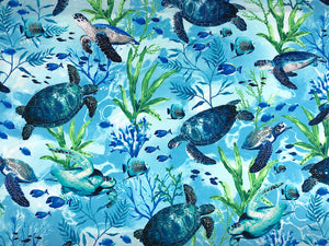 Cotton fabric covered with swimming sea turtles.