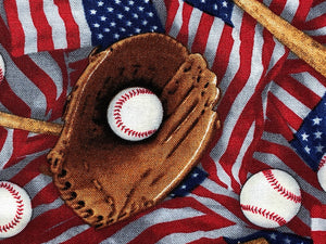 Close up of cotton fabric that is covered with flags, baseballs, baseball bats, and baseball gloves.