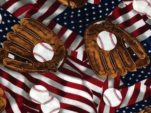 Close up of flags, baseballs and gloves.