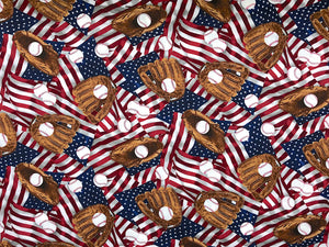 Cotton fabric covered with USA Flags, baseballs and baseball gloves.