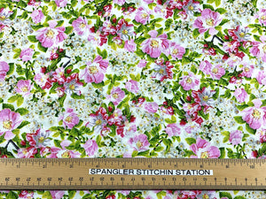 Ruler on cotton fabric covered with dogwood flowers.