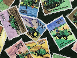 Close up of green cotton fabric covered with John Deer stamps.