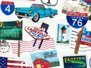 Close up of various travel stamps, blue car and a sign that says drive carefully come back soon.