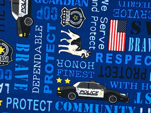 Close up of police cars, dog, the USA flag and sayings.