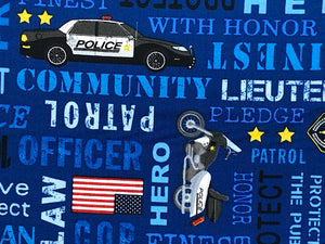 Close up of blue fabric covered with police cars and words such as pledge, office, hero and more.