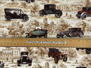 Ruler on fabric to show sizing of the vintage cars.