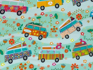 Close up of vans going down a road surrounded by flowers