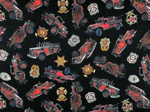 Black cotton fabric covered with firetrucks and shields.