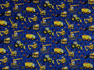 Blue fabric covered with dump trucks, backhoes and other construction equipment.