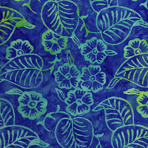 Close up of blue batik fabric that is covered with flowers and leaves.