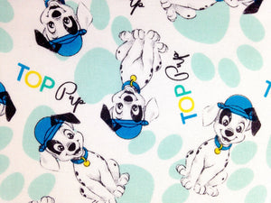 Close up of Dalmatians on white cotton fabric