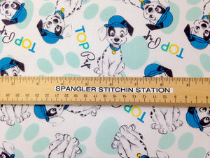 Ruler on fabric to show sizing of dogs