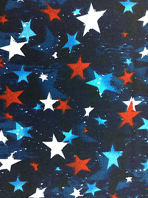 Close up of blue fabric covered with red, white and blue stars.