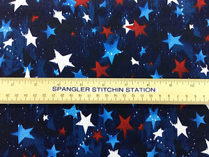 Ruler on blue fabric that is covered with red, white and blue stars.