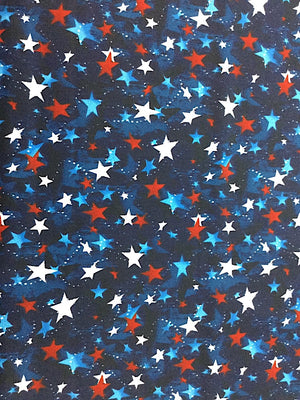 Blue cotton fabric covered with red, white and blue stars.
