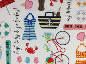 Close up of Vintage Boardwalk fabric covered with crabs, ice cream cones and bikes.