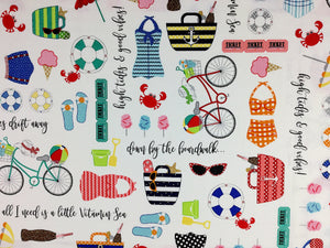 Cotton fabric covered with nautical items such as flip flops, bikes, sunglasses and swim suits