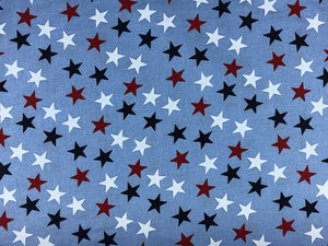 Wide blue cotton fabric covered with red, white and blue stars.
