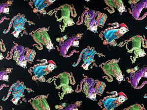 Black cotton fabric covered with cats wearing santa hats and playing with ornaments or lights.