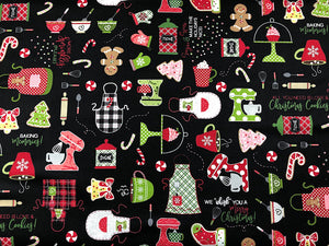 Black Cotton Fabric covered with kitchen items such as blenders, aprons, cups rolling pins and more.
