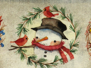 Close up of a snowman looking at a red bird on cotton fabric