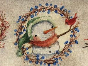 Close up of a snowmen and red bird on cotton fabric