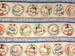 Cotton fabric covered with rows of snowmen