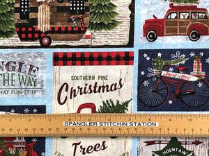 Ruler on cotton fabric that is covered with red trucks, bicycles, RV's, Christmas trees and more.