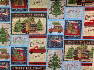 Cotton fabric covered with red trucks, Christmas trees, RV's, bicycles and Christmas sayings.