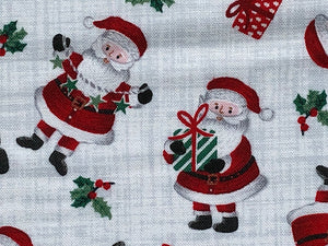 Close up of cotton fabric that is covered in Santa's