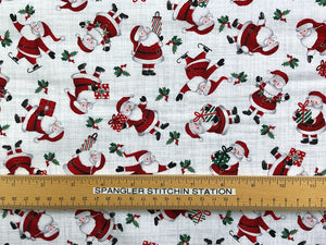 Ruler on cotton fabric that is covered in Santa's.