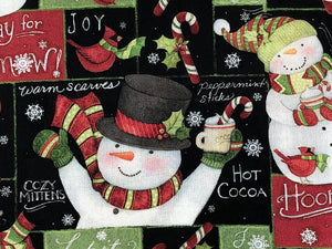 Close up of black cotton fabric covered with snowmen.