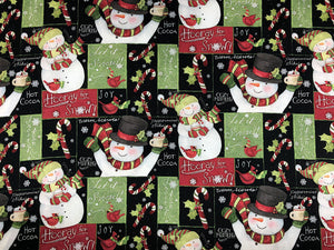 Black cotton fabric covered with snowmen  and snow sayings.