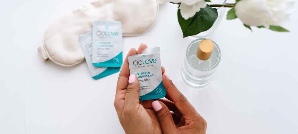 An older woman holding a sample of GoLove CBD lube