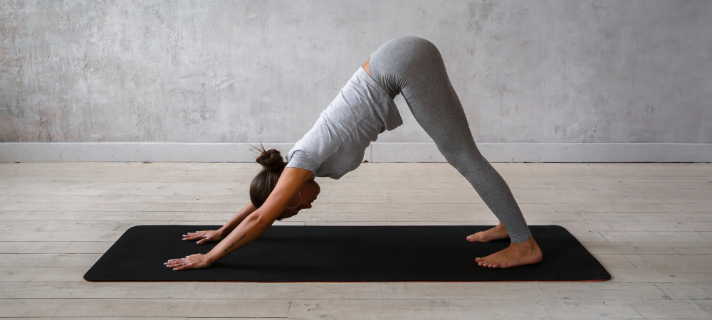 Woman in downward facing dog position