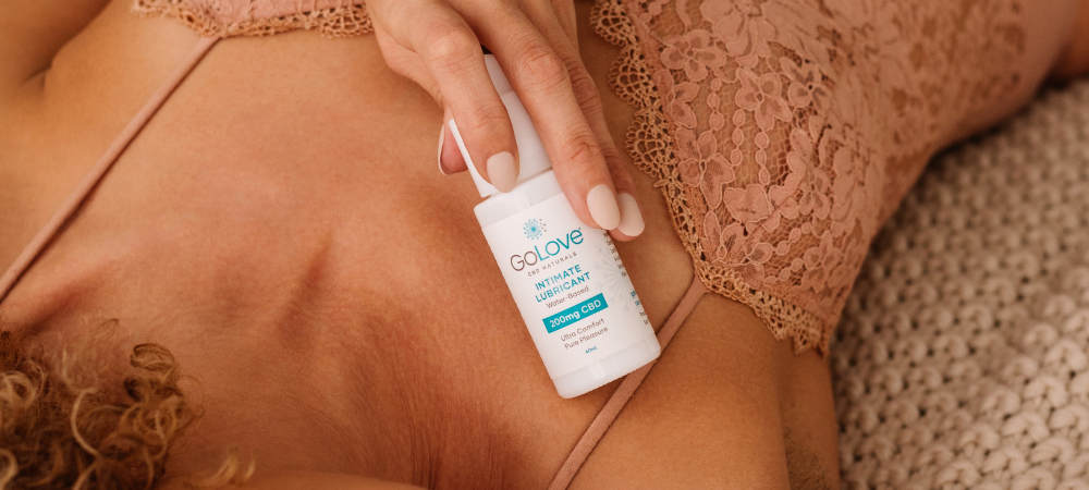 A woman laying on her back with GoLove CBD lube