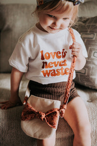LOVE IS NEVER WASTED KIDS TEE