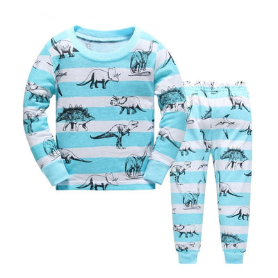 Light blue and white striped dinosaur pajamas for kids. Stenciled on top are T-Rex, Triceratops, Stegosaurus, and Brontosaurus's all over.