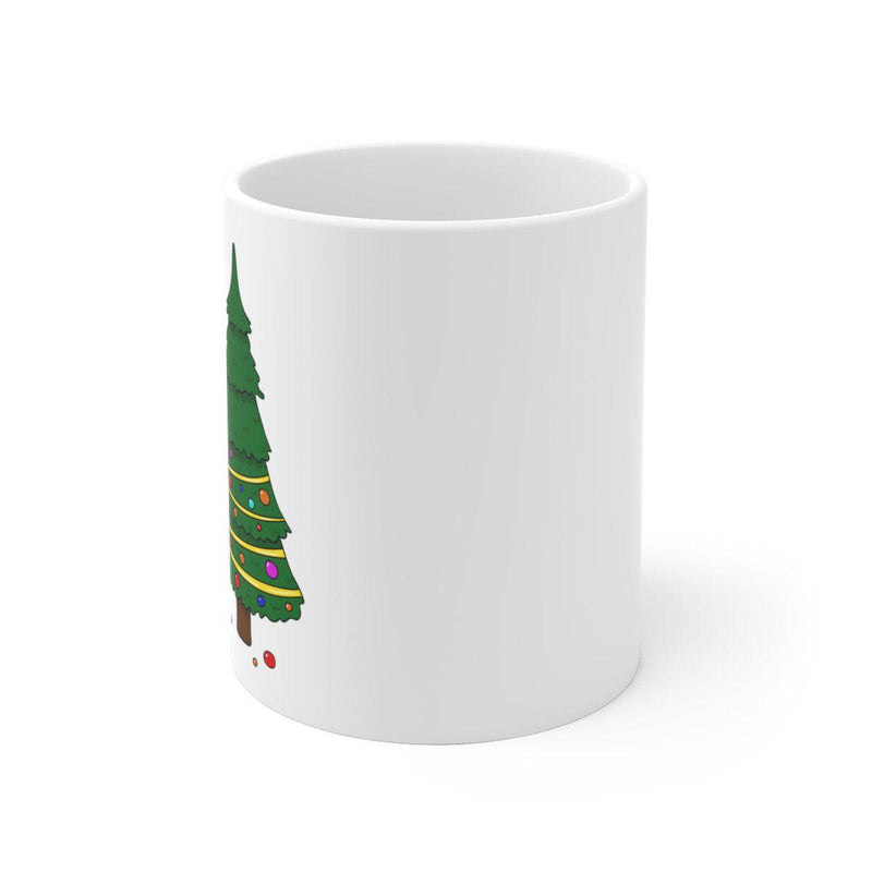 Christmas dinosaur mug where T-Rex is trying to figure out how to decorate the top half of his christmas tree with his tiny arms.