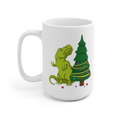 15 oz dinosaur mug with a tiny armed t-rex looking distraught because the top of the Christmas tree is out of his reach.