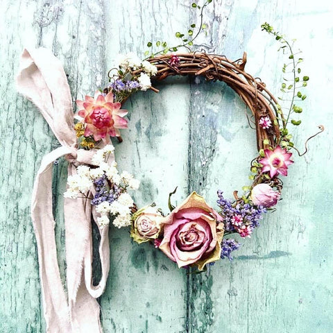 dried flower wreath with roses