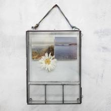 Box Photo Frame with 4 compartments made from glass and metal hanging on a wall
