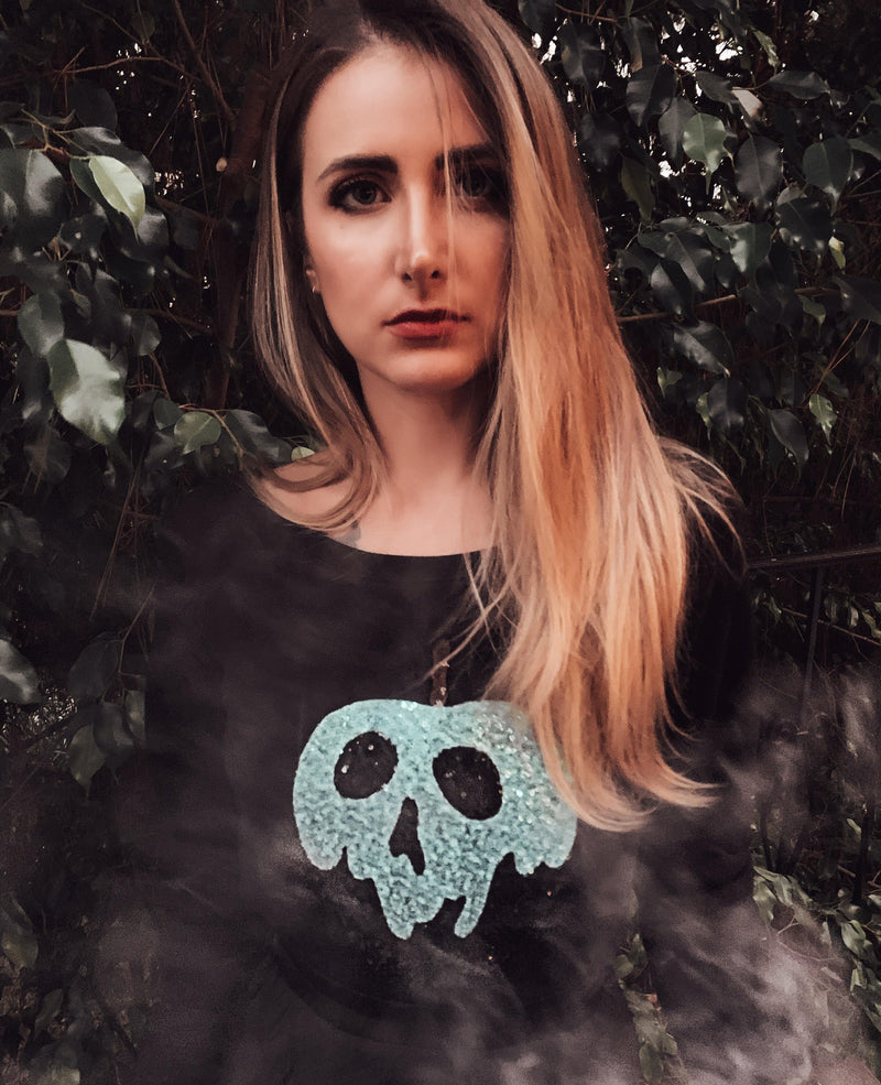 Model wearing blue and black poison apple sequin sweatshirt